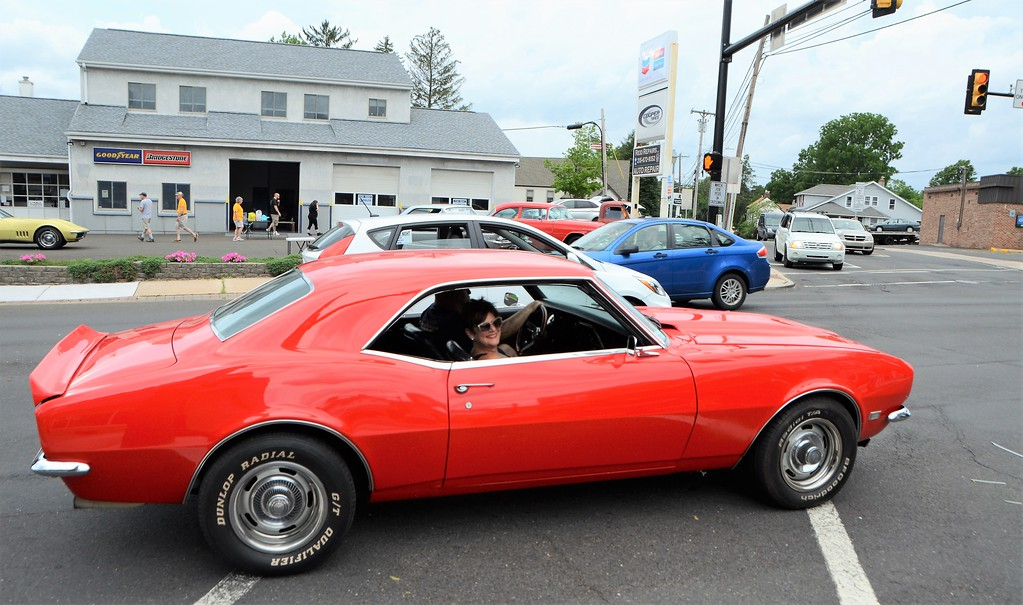 . Susan Bernard, of Willow Grove, cruises down York Road in her red corvette during the Greater Hatboro Chamber of Commerce�s first Cruise Night of the summer along York Road June 23.
