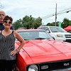 Bob and Susan Bernard, of Willow Grove, stand with their red corvette during the Greater Hatboro Chamber of Commerce's first Cruise Night of the summer along York Road June 23.