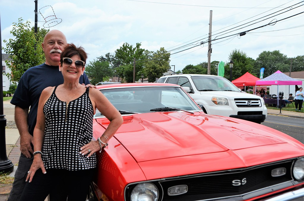 . Bob and Susan Bernard, of Willow Grove, stand with their red corvette during the Greater Hatboro Chamber of Commerce�s first Cruise Night of the summer along York Road June 23.