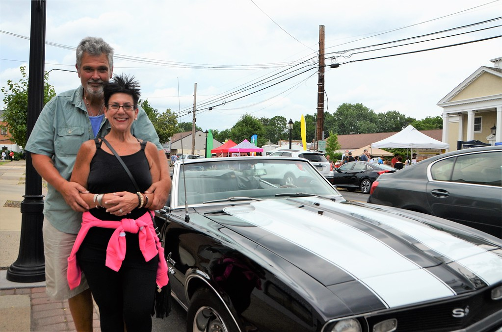. Greg and Andi Custer stand with their black-and-white corvette during the Greater Hatboro Chamber of Commerce�s Cruise Night June 23.