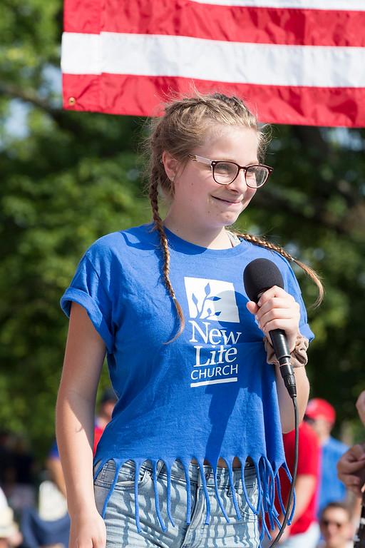 . Olivia Morris sings on the New Life Church float.  Rachel Wisniewski � For Digital First Media