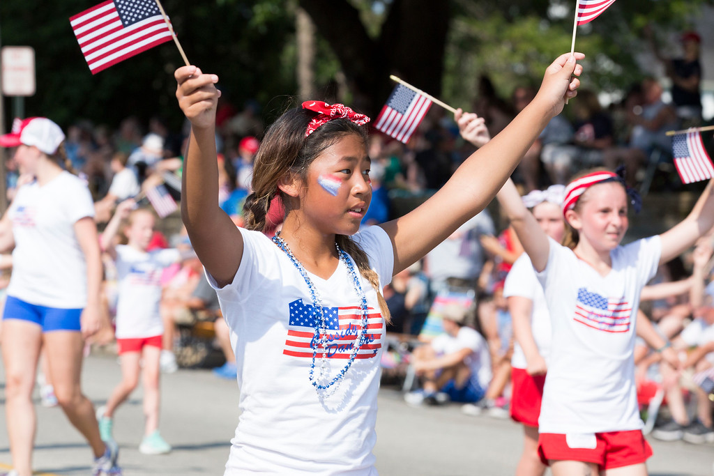 . Girls from the Cassidy Dance School perform a dance routine while waving American flags during the Greater Glenside Patriotic Association�s annual Grand, Glorious, Patriotic Parade on the Fourth of July.  Rachel Wisniewski � For Digital First Media