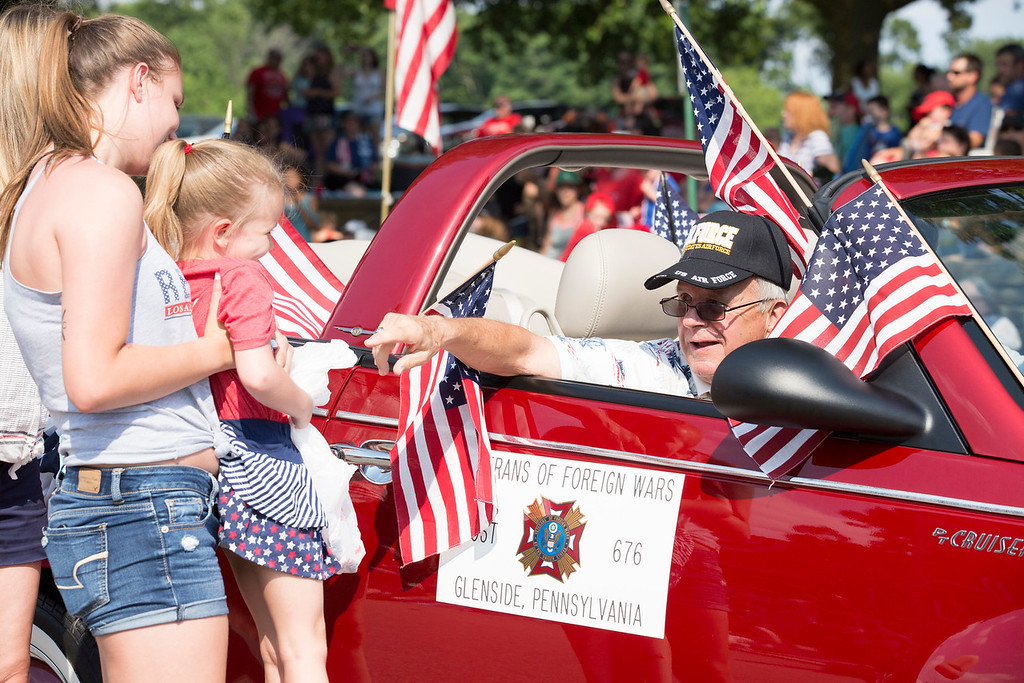 . Bill Marren, a member of the Veterans of Foreign Wars Post 676, right, is greeted by family members as his float momentarily comes to a stop.  Rachel Wisniewski � For Digital First Media