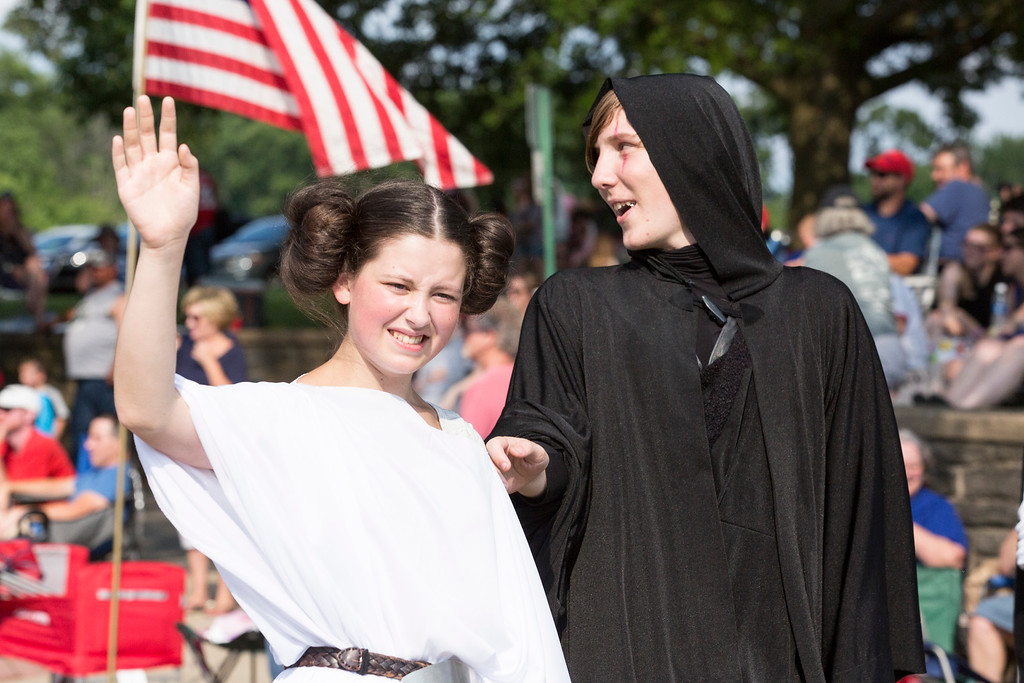 . Boys and girls dressed as Star Wars characters walk with a Star Wars 40th anniversary-inspired float.  Rachel Wisniewski � For Digital First Media