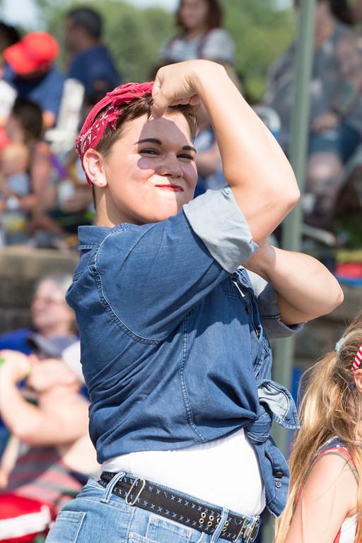 . A paradegoer emulates Rosie the Riveter.  Rachel Wisniewski � For Digital First Media