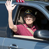 A member of the Veterans of Foreign Wars Post 676 waves to the crowd.  Rachel Wisniewski — For Digital First Media