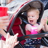Riley Cooper, 2, cannot contain her excitement as she sees fire trucks pass in the parade.  Rachel Wisniewski — For Digital First Media