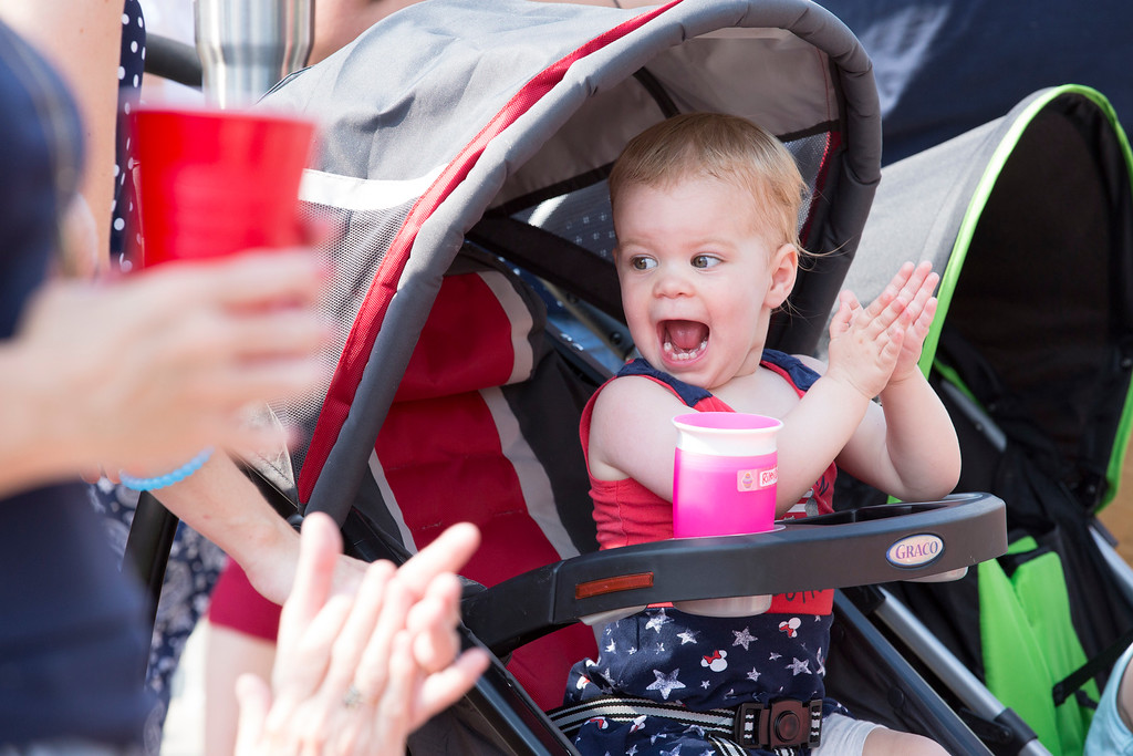 . Riley Cooper, 2, cannot contain her excitement as she sees fire trucks pass in the parade.  Rachel Wisniewski � For Digital First Media