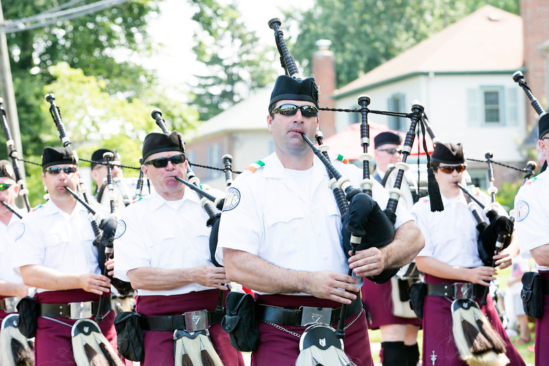 Members of Montgomery County's Irish Thunder play bagpipes as they march.  Rachel Wisniewski — For Digital First Media