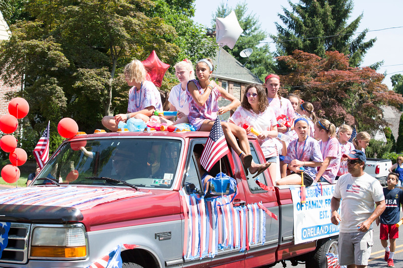 Members of the Oreland Swim Club fill a pickup truck dressed in red, white and blue.  Rachel Wisniewski — For Digital First Media