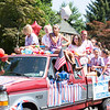 Members of the Oreland Swim Club fill a pickup truck dressed in red, white and blue.  Rachel Wisniewski — For Digital First Media