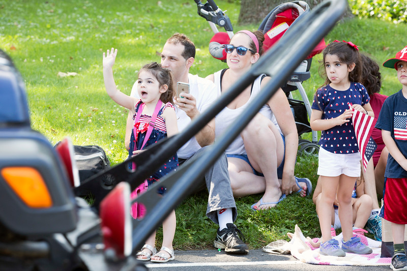 Alessandra L'Erario, 3, left, waves at a car in the parade.  Rachel Wisniewski — For Digital First Media