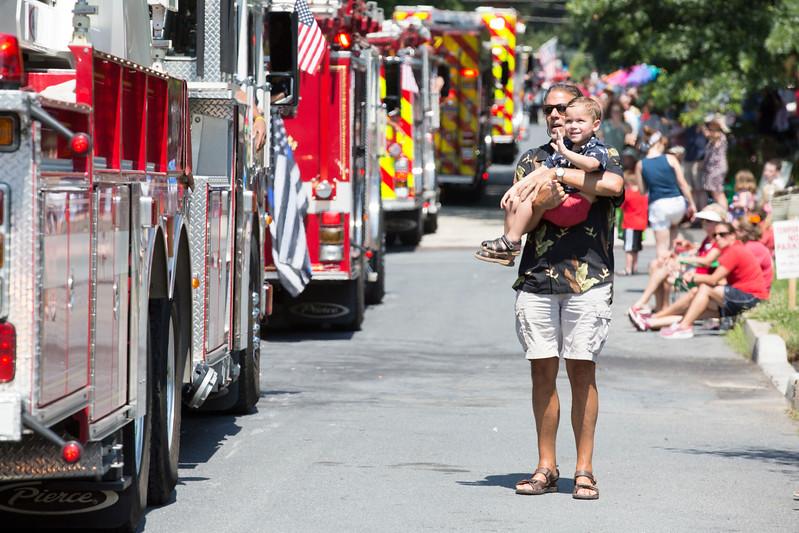 Braeden Miller waves at Glenside fire trucks as his uncle, Bill Sargis, holds him.  Rachel Wisniewski — For Digital First Media