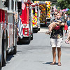 Braeden Miller waves at Glenside fire trucks as his uncle, Bill Sargis, holds him.  Rachel Wisniewski — For Digital First Media