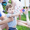 Reid Herzog, 18 months, shows his patriotism by waving two miniature American flags.  Rachel Wisniewski — For Digital First Media
