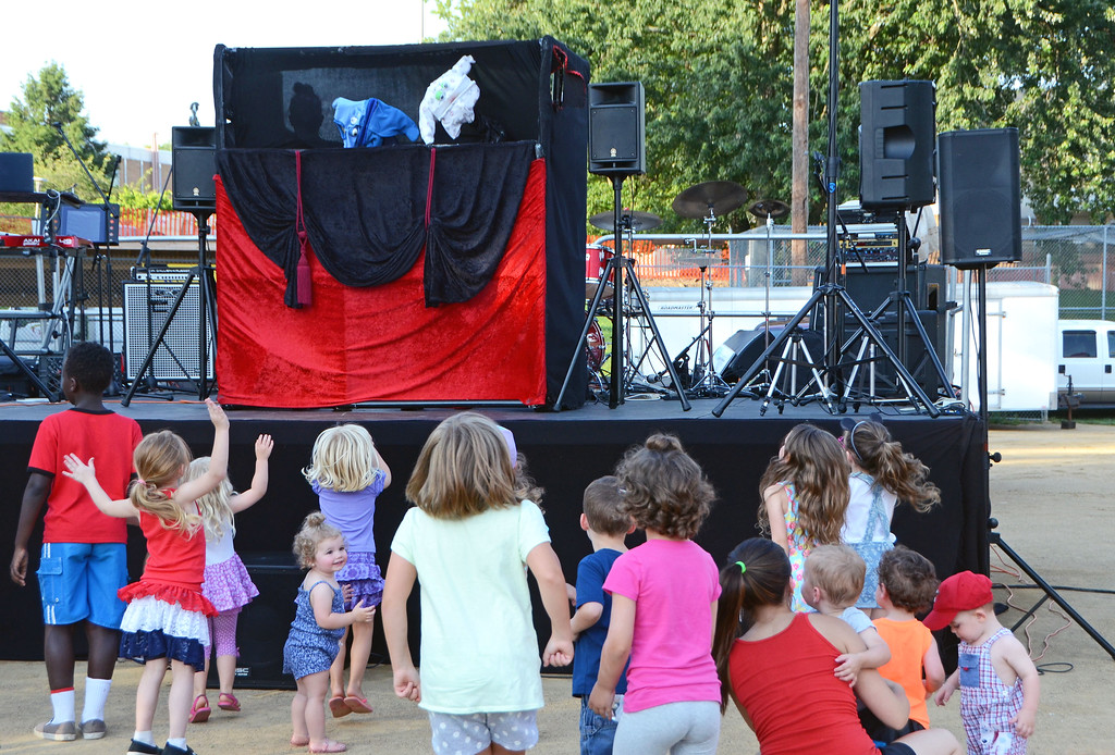 . Children enjoy a puppet show at Southampton Days.  Christine Wolkin � For Digital First Media