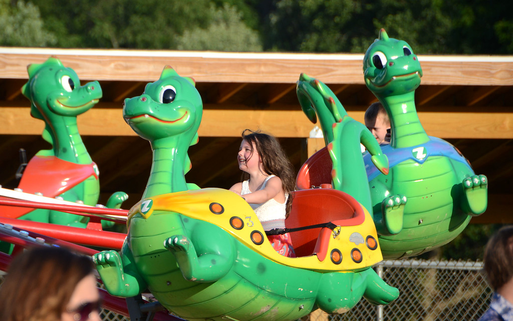 . A young fairgoer enjoys the dinosaur ride at Southampton Days.  Christine Wolkin � For Digital First Media