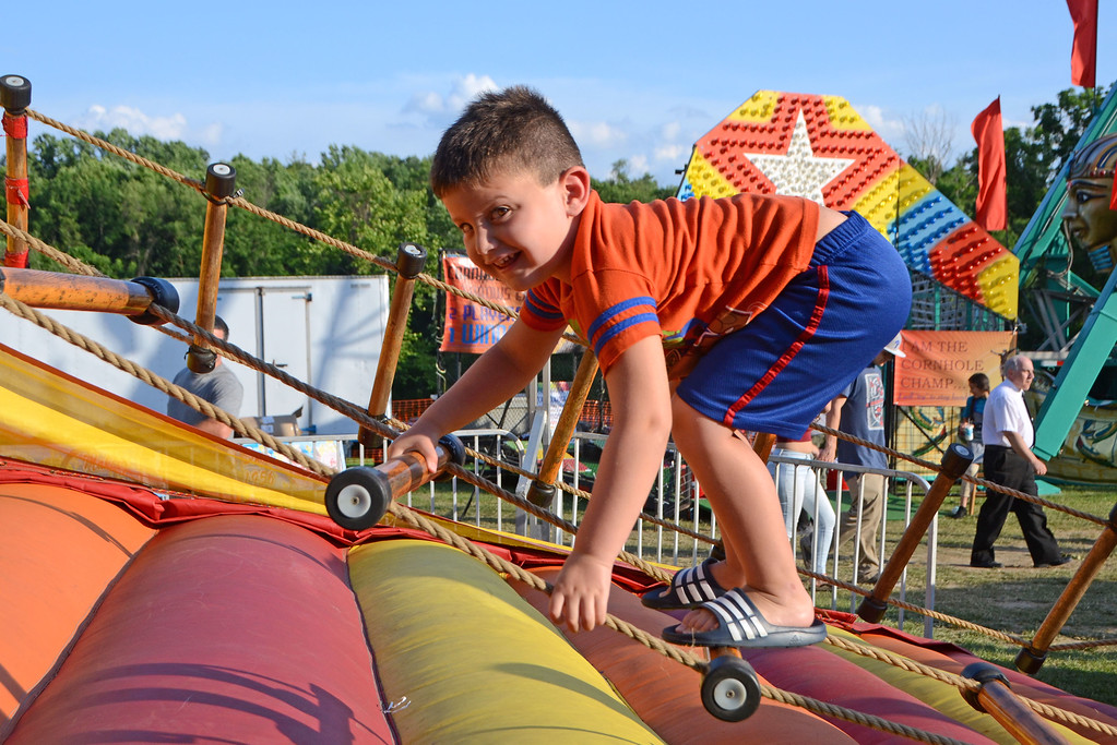 . Alex Cohen, of Warwick, tries climbing Lagoomy Ladders for a prize during the Southampton Days Fair July 3.  Christine Wolkin � For Digital First Media