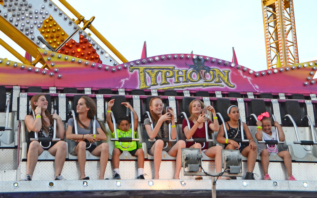 . Fairgoers take on the Typhoon at Southampton Days.  Christine Wolkin � For Digital First Media