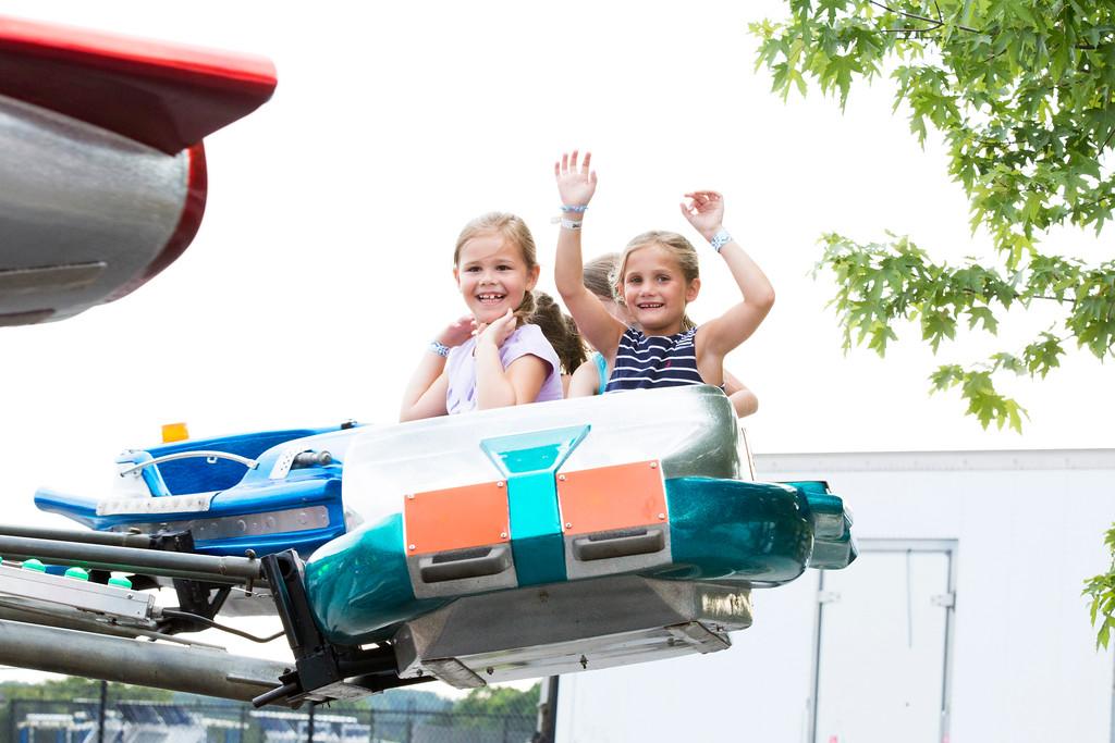 . Katie Schneider and Charlotte Sullivan throw their hands up on an airplane ride. Behind them sit their friends, Scarlett Stewart and Leah Caruso.  Rachel Wisniewski � For Digital First Media