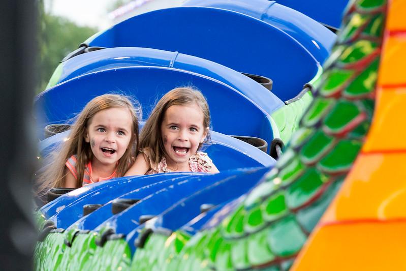Identical twins Ava and Milla McLaughlin, 5, scream as they ride the Dragon Wagon.  Rachel Wisniewski — For Digital First Media