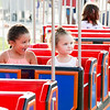 Nyla, left, and Alana Jackson ride the Train Station attraction.  Rachel Wisniewski — For Digital First Media