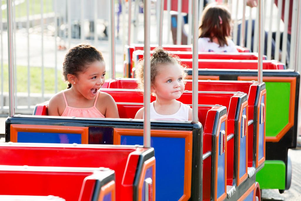 . Nyla, left, and Alana Jackson ride the Train Station attraction.  Rachel Wisniewski � For Digital First Media