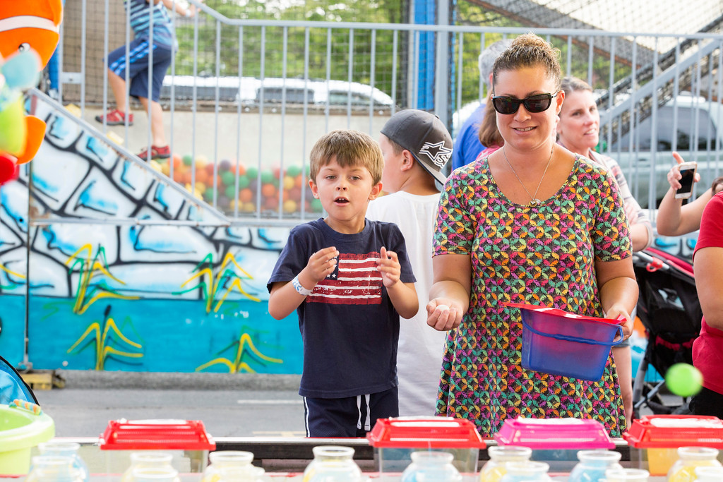 . Jeffrey Gulla, 4, attempts to win a goldfish with assistance from his mother, Kristen.  Rachel Wisniewski � For Digital First Media