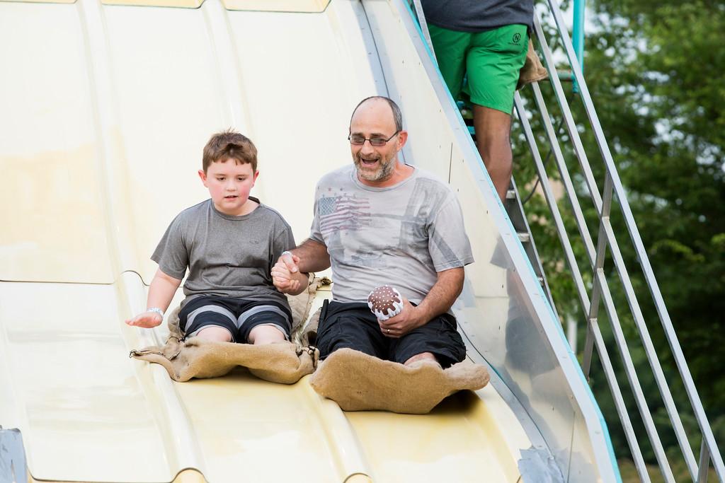 . Charles Dejulib, right, and his son, Aidan, ride the Super Slide.  Rachel Wisniewski � For Digital First Media