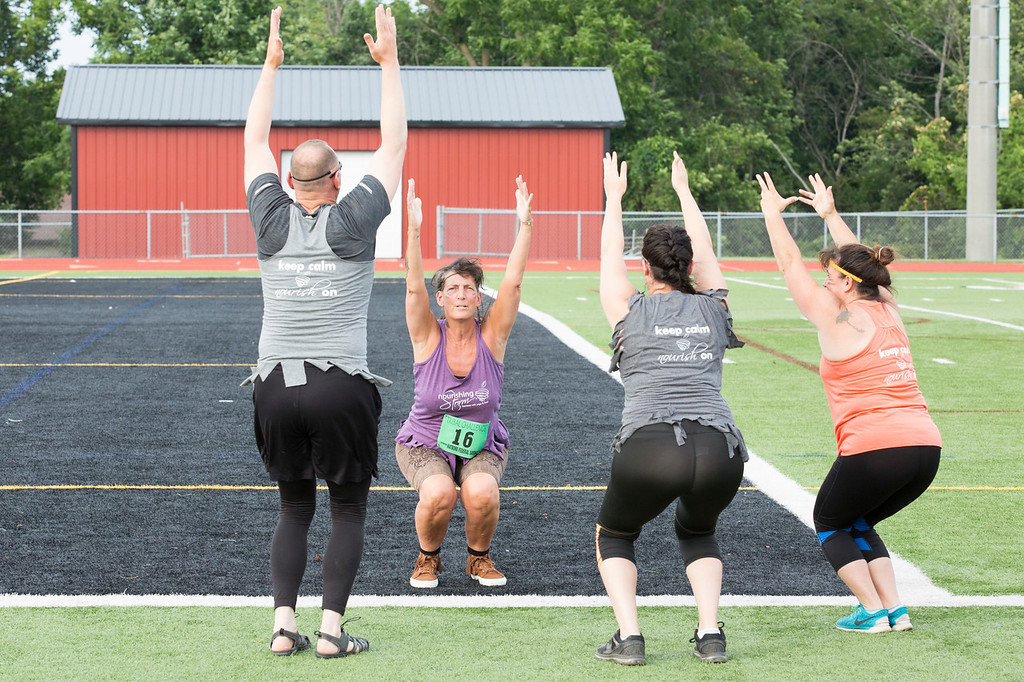 . Mindy Cassidy, second to left, leads a yoga exercise for her team, the Nourishing Warriors from Nourishing Storm yoga studio in Hatboro. The team is using yoga as a method of physical and mental preparation for the Hatboro Rotary Club�s annual Tribal Challenge, a 3-mile team obstacle course occurring July 12. Proceeds benefited local charities such as the Hatboro YMCA�s financial assistance program.  Rachel Wisniewski � For Digital First Media