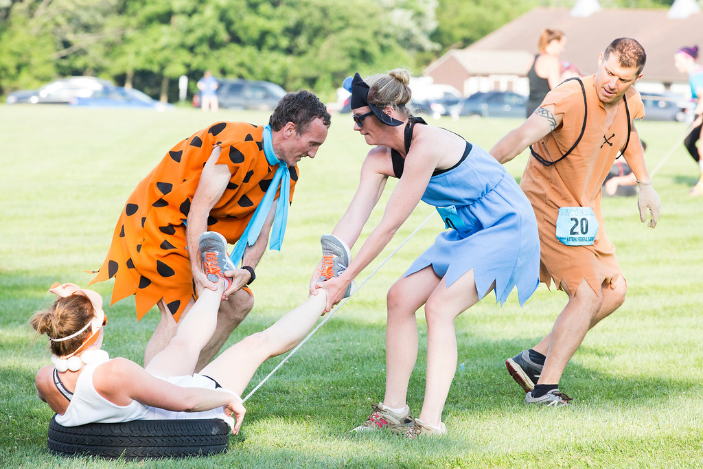 . A team dressed as the Flintstones works to complete the second challenge: a tire pull.  Rachel Wisniewski � For Digital First Media