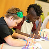 Students work on a project during the Science in the Summer program at the Elkins Park Library July 23. The class studied the science of space. Harrison Brink — For Digital First Media