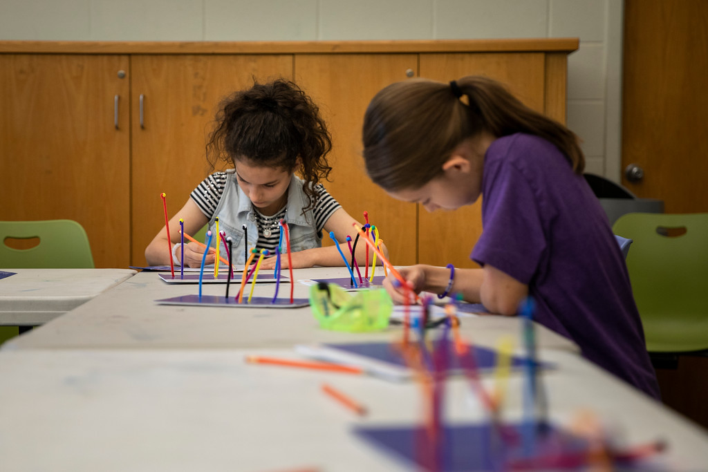 . Students work on a project during the Science in the Summer program at the Elkins Park Library July 23. The class studied the science of space. Harrison Brink � For Digital First Media