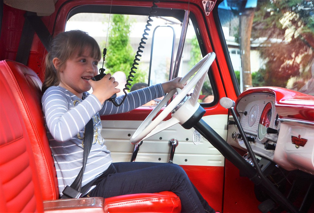 . Isabelle Delfino, of Souderton, tests out Steve McBlane�s 1965 Ford Pickup during Hatboro�s 25th annual Moonlight Memories Car Show July 29.  Christine Wolkin � For Digital First Media