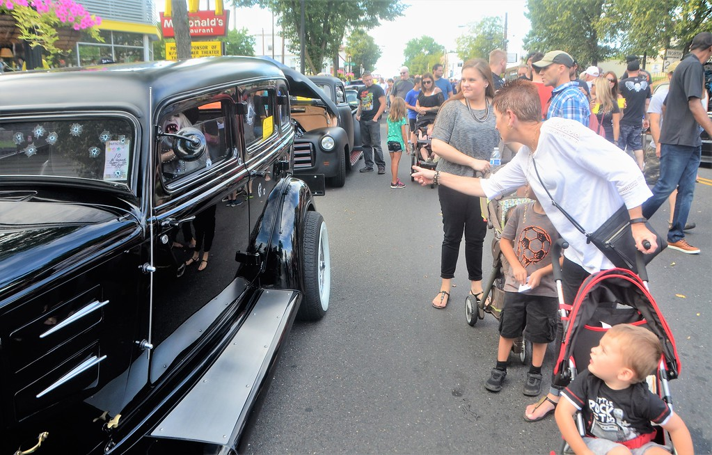 . Attendees notice an unusual driver behind the wheel of this replica of Al Capone�s 1928 Cadillac during Hatboro�s 25th annual Moonlight Memories Car Show July 29.  Christine Wolkin � For Digital First Media