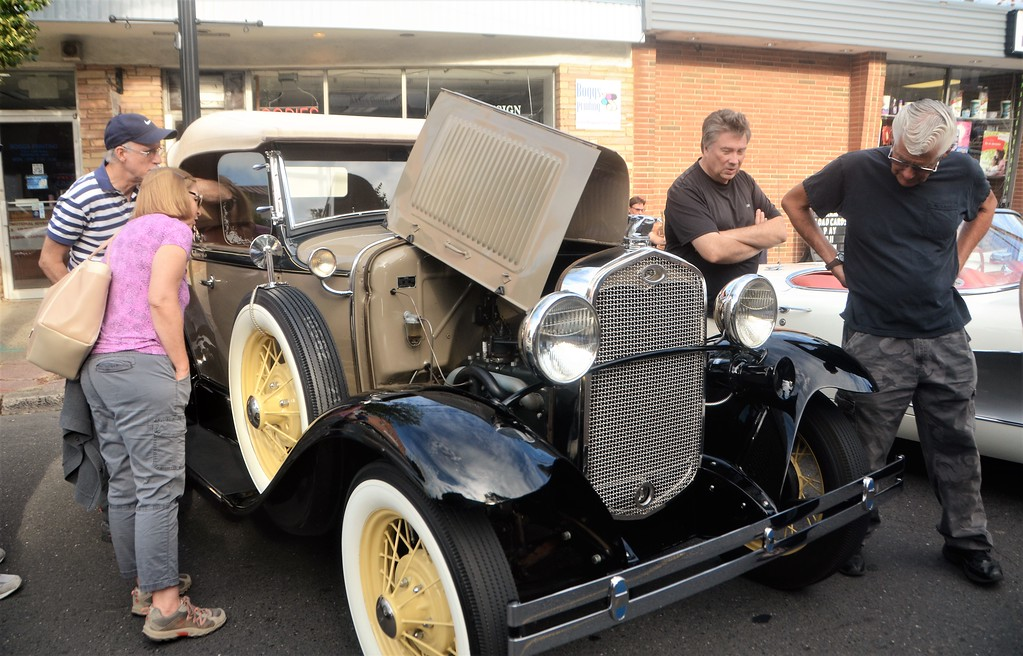 . Car enthusiasts get a closer look at this 1931 Ford Deluxe Roadster during Hatboro�s 25th annual Moonlight Memories Car Show July 29.  Christine Wolkin � For Digital First Media