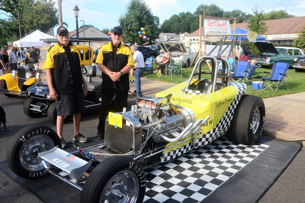 . Brothers Bill, left, and Bob Spencer represent Bob�s 1923 California Dreamin� race car during Hatboro�s 25th annual Moonlight Memories Car Show July 29.  Christine Wolkin � For Digital First Media
