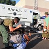 Julian Lorenc, of Ambler, tries on a S.W.A.T. vest outside the Montgomery County East Region S.W.A.T. Team van during Horsham's National Night Out Aug. 1 outside the Horsham Municipal Complex. National Night Out is designed to raise drug and crime prevention awareness and to promote police-community partnership.  Christine Wolkin — For Digital First Media
