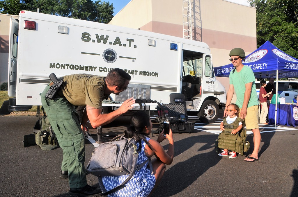 . Julian Lorenc, of Ambler, tries on a S.W.A.T. vest outside the Montgomery County East Region S.W.A.T. Team van during Horsham�s National Night Out Aug. 1 outside the Horsham Municipal Complex. National Night Out is designed to raise drug and crime prevention awareness and to promote police-community partnership.  Christine Wolkin � For Digital First Media