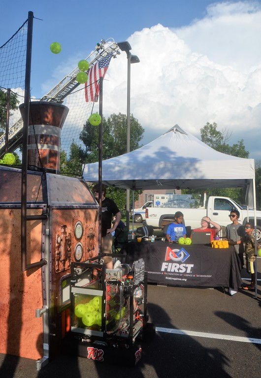 . Members of the Hatboro-Horsham High School robotics team demonstrate their robot, known as �Night Rider,� during Horsham�s National Night Out Aug. 1 outside the Horsham Municipal Complex.  Christine Wolkin � For Digital First Media