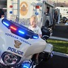 Adam Yacko, of Perkasie, sits on a Horsham Township police cruiser during Horsham's National Night Out Aug. 1 outside the Horsham Municipal Complex.  Christine Wolkin — For Digital First Media