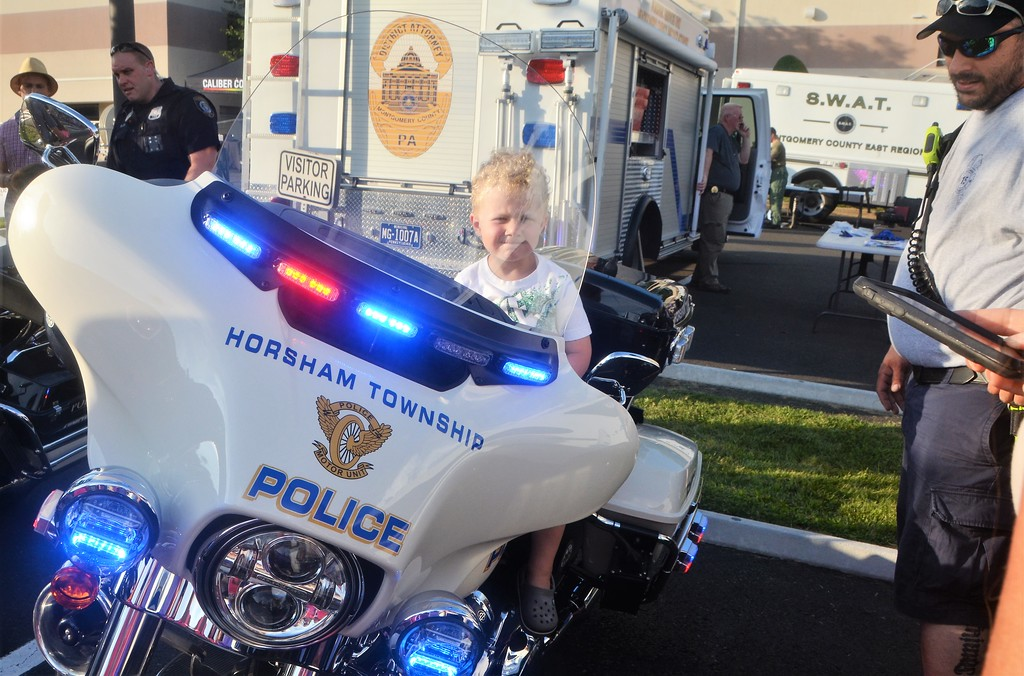 . Adam Yacko, of Perkasie, sits on a Horsham Township police cruiser during Horsham�s National Night Out Aug. 1 outside the Horsham Municipal Complex.  Christine Wolkin � For Digital First Media