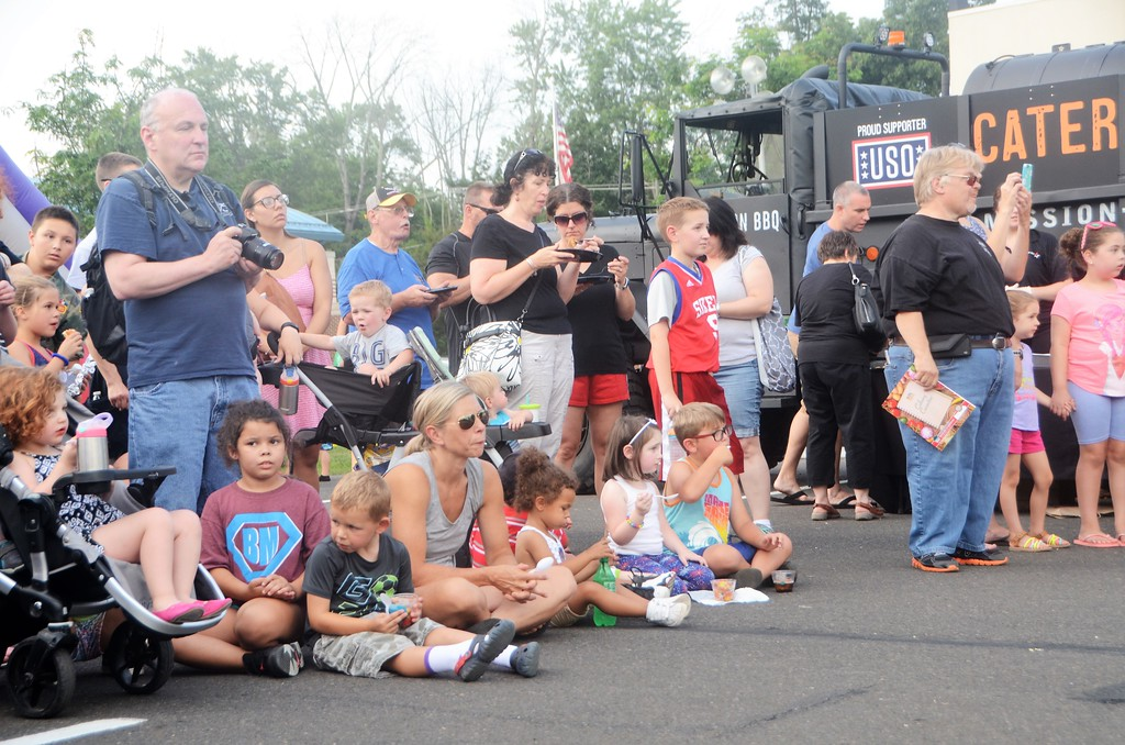 . The crowd gathers to watch a K-9 demonstration during the town�s National Night Out Aug. 1 outside the Horsham Municipal Complex.  Christine Wolkin � For Digital First Media