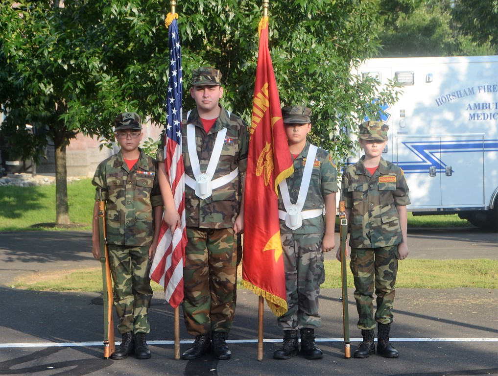 . Lance Cpl. Miller, left, Cpl. Teti and Lance Cpl. Salters of the United Young Marines conduct the flag ceremony opening Horsham�s National Night Out Aug. 1 outside the Horsham Municipal Complex.  Christine Wolkin � For Digital First Media