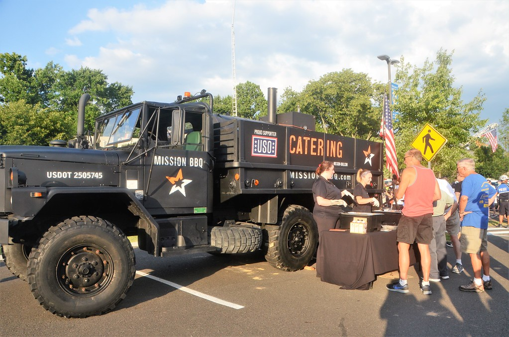 . Mission BBQ, a barbecue joint that gives back to veterans through USO donations, serves up food during Horsham�s National Night Out Aug. 1 outside the Horsham Municipal Complex.  Christine Wolkin � For Digital First Media