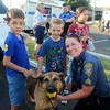 Everett Rao, of Maple Glen, left, and Dylan Augustine, of Hatboro, are introduced to Bella, one of Abington police's K-9 dogs by Sgt. Jennifer Doyle during Horsham's National Night Out Aug. 1 outside the Horsham Municipal Complex.  Christine Wolkin — For Digital First Media