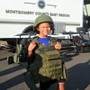 Major White, of Horsham, tries on a S.W.A.T. vest outside the Montgomery County East Region S.W.A.T. Team van during Horsham's National Night Out Aug. 1 outside the Horsham Municipal Complex.  Christine Wolkin — For Digital First Media