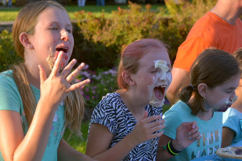 Three girls getting messy at the Souderton Community Night pie eating contest Aug. 8, 2017.  //  Bob Raines--Digital First Media
