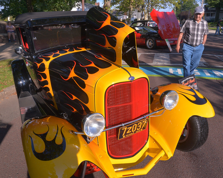 "Walter Detwiler takes a look at John and Joan Logrando's 1931 Ford sport coupe, ""Sweet Heat,"" at Souderton Community Day Aug. 8, 2017.  //  Bob Raines--Digital First Media"