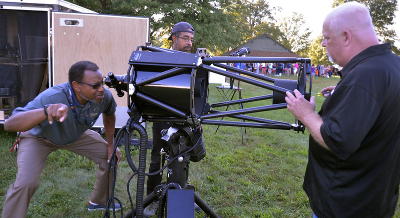 Derrick Pitts, left, chief astronomist at the Franklin Institute, helps Ed Anderson, right, DarkSky on Demand, align the hyperbolic mirrors on a 14-inch RC telescope Aug 8, 2017. Also with DarkSky is Henry Naylor, center.  //  Bob Raines--Digital First Media